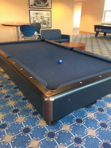 Modern day pool table with a single billiards ball on table